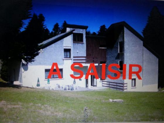 chalet face aux pistes comprenant 7 appartements au mourtis
